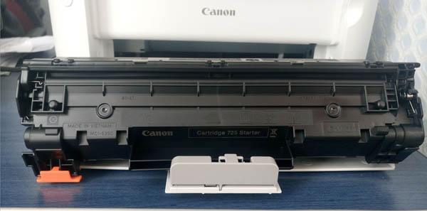 где находится картридж в принтере canon